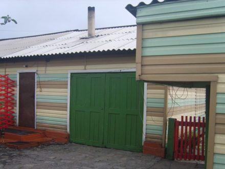 Продам трехкомнатную квартиру на 1-м этаже 1-этажного дома площадью 98 кв. м. в Кызыле